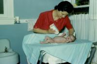 May, 1961. Barbara Jean (Lowing) Brink with Jeanne Marie Brink at 2 weeks old.