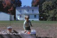 August, 1963. Jeanne Marie Brink and sandbox at Irwin Jay Brink Residence - 721 Lugers road, Holland, Michgan.