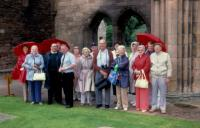 August, 1987. Elgin (Scotland) - Cathedral Ruins. Left to right : Barbara Jean (Lowing) Brink, ?, (Pastor) Willis Jones.