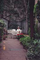 July, 2000. Barbara Jean (Lowing) Brink, Hotel courtyard, Paris, France